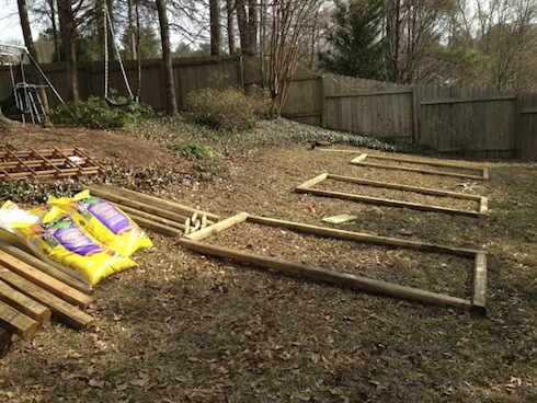 After cutting the necessary landscape timbers into half lengths, the next step was to lay out the location of the beds.