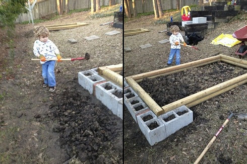 Aiden was a big help in building the retaining walls! I used cinder blocks that I filled with soil so that they could be used for plants as well.